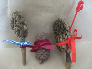 Pick up pine cone or other cone tie ribbon around it in some fetching